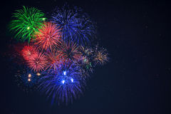 Beautiful blue green red celebration fireworks copy space Stock Photo