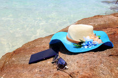 Beautiful blue hat , mobile and sunglasses on the stone Stock Images