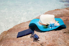 Beautiful blue hat , mobile and sunglasses on the stone Royalty Free Stock Photo