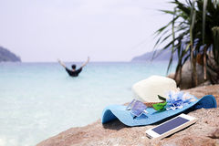 Beautiful blue hat , mobile and sunglasses on the stone with wit Stock Image