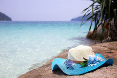 Beautiful blue hat and sunglasses on the stone Stock Photo