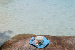 Beautiful blue hat and sunglasses on the stone Stock Images
