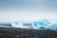 Beautiful blue icebergs on the coast of the Atlantic ocean Royalty Free Stock Photos