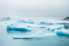 Beautiful blue icebergs in Jokulsarlon glacial lagoon, Iceland Royalty Free Stock Images