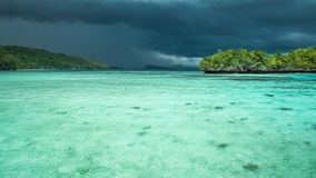 Beautiful blue lagoon with pure clear water shortly before thunderstorm begining, Gam Island, West Papua, Raja Ampat. Indonesia stock footage