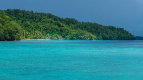 Beautiful Blue Lagoone shortly before Thunderstorm, Gam Island, West Papuan, Raja Ampat, Indonesia Royalty Free Stock Photography