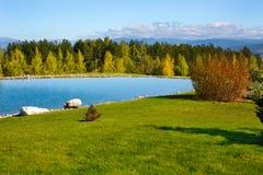 Beautiful blue Lake, colorful autumn trees and Stock Photos