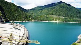 Beautiful blue lake on a dam, a hydroelectric power station Stock Photos