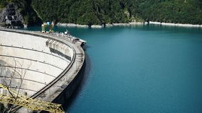 Beautiful blue lake on a dam, a hydroelectric power station Royalty Free Stock Images