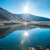 Beautiful blue lake in the mountains Stock Photos
