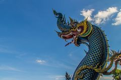 Free Beautiful Blue Naga Sculpture With Blue Sky And White Cloud On T Royalty Free Stock Photos - 108127418