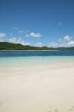 Beautiful blue ocean and white sand beach. Stock Photo