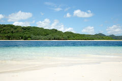 Beautiful blue ocean and white sand beach. Royalty Free Stock Image