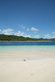 Beautiful blue ocean and white sand beach. Royalty Free Stock Photography