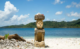 Beautiful blue ocean and white sand beach and stone man carving. Royalty Free Stock Photos