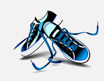 Beautiful blue pair of sneakers Stock Images