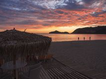 Beautiful blue pink orange clouds after sunset on Agios Georgios Pagon beach at Corfu island, Greece with sun umbrellas stock photography