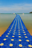 Beautiful blue pontoon made from plastic floating in the sea, ro Stock Photos