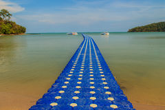 Beautiful blue pontoon made from plastic floating in the sea, rotomolding jetty, a landing stage or small pier at which boats can