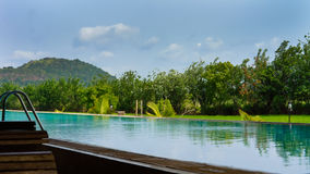 Beautiful blue pool with tropical vegetation Royalty Free Stock Image