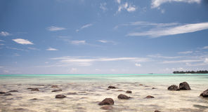 Beautiful blue rocky beach at Mon Choisy in Mauritius Royalty Free Stock Image