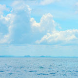 Beautiful blue sea and clouds on sky with big steamship Stock Photos