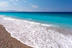 View on amazing Akti Miaouli Beach in Rhodes town, Greece. Beautiful blue sea on greek island Rhodes stock photo