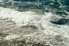 Beautiful blue sea stormy waves with white foam Stock Image