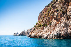 Beautiful blue sea and the wild rocks. Summer landscape. Alanya, Turkey Royalty Free Stock Photo