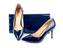 Beautiful  blue shoes with clutches on isolated background Stock Images