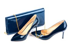 Beautiful blue shoes with clutches on isolated background Royalty Free Stock Photo