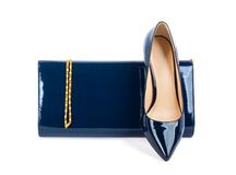 Beautiful blue shoes with clutches on isolated background Royalty Free Stock Photos