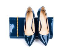 Beautiful blue shoes with clutches on isolated background Royalty Free Stock Images