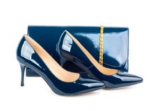 Beautiful blue shoes with clutches on  isolated background Stock Photography