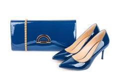 Beautiful blue shoes with clutches on  isolated background Stock Image