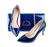 Beautiful blue shoes with clutches on solated background Royalty Free Stock Image
