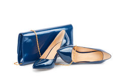 Beautiful blue shoes with clutches on white background Stock Photos