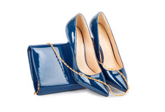 Beautiful blue shoes with clutches on white background Stock Images