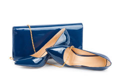 Beautiful blue shoes with clutches on white background Royalty Free Stock Photos