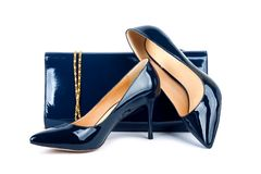 Beautiful  blue shoes with clutches on white isolated Stock Photography
