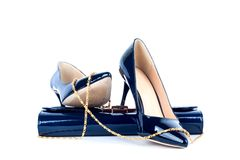 Beautiful blue shoes with clutches Stock Image