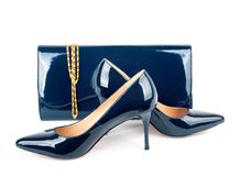 Beautiful blue shoes with clutches on white isolated Royalty Free Stock Photos