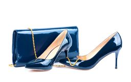 Beautiful blue shoes with clutches on white isolated Stock Photos