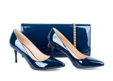 Beautiful blue shoes with clutches on white isolated Stock Images