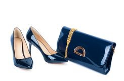 Beautiful blue shoes with clutches on white isolated Royalty Free Stock Images