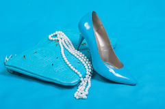 Beautiful blue shoes and handbag, pearls Royalty Free Stock Photography