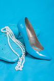 Beautiful blue shoes and handbag, pearls Stock Photo