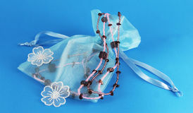Beautiful Blue Silk Bag With Beaded Necklace Stock Photo
