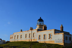 Beautiful Blue Skies Behind Neist Point Lighthouse in Scotland Royalty Free Stock Image