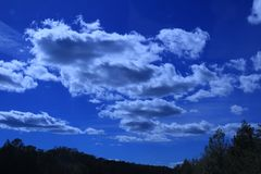 Blue skies with clouds over mountains. stock photography